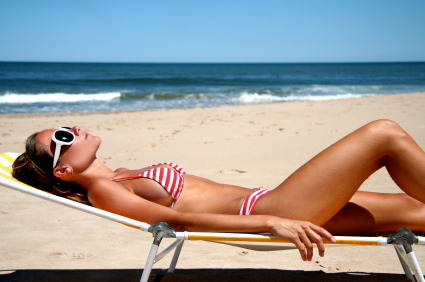 the woman is wearing sunglasses and swimsuit